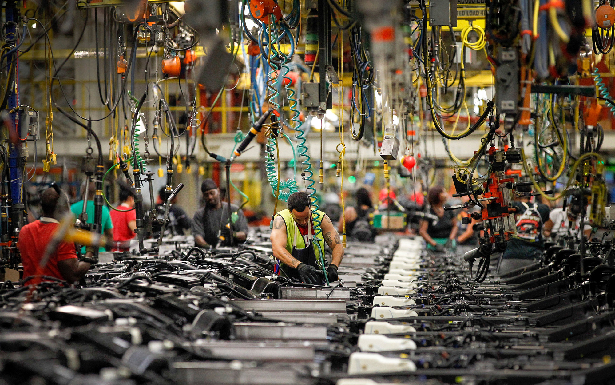 This is a picture of a man working on the assembly line at the General Motors Arlington Assembly Plant in Texas.