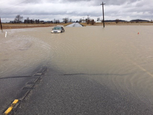 This is a picture of a car submerged in heavy flooding in St. Joseph County, Indiana.