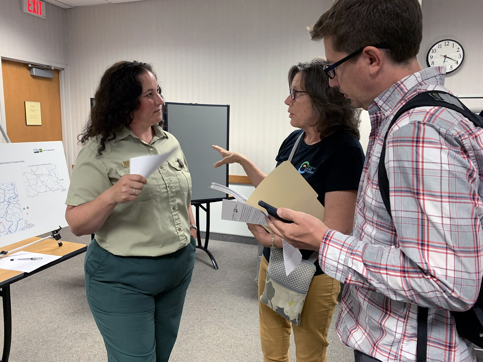 This is a picture of Friends of Lake Monroe president Sherry Mitchell-Bruker speaking with District Ranger Michelle Paduani at an open house meeting Aug. 7