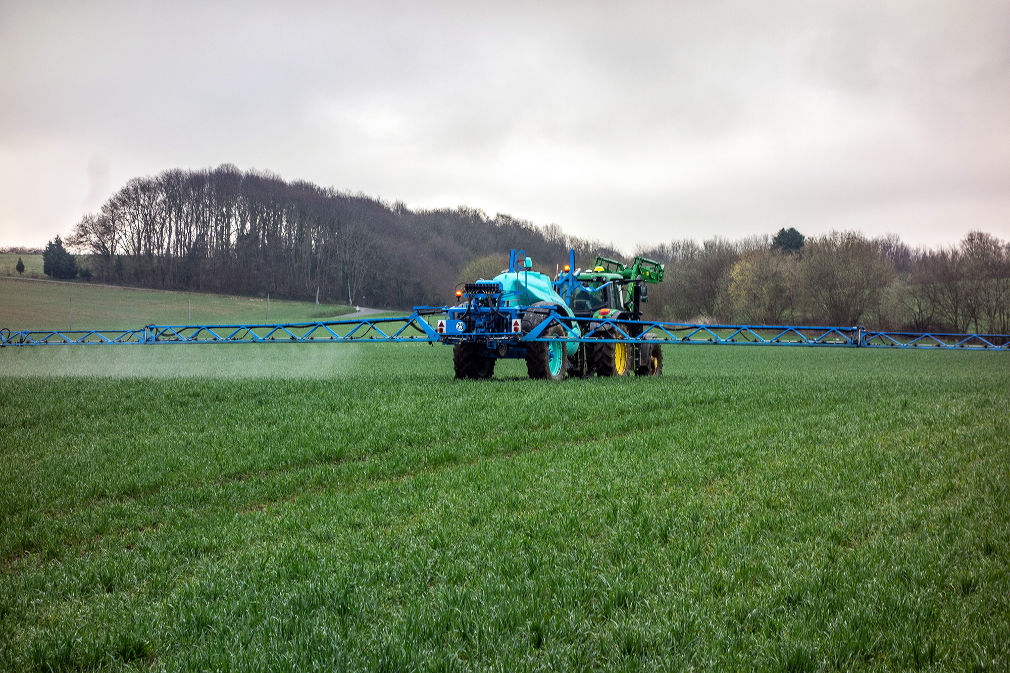 Photo of pesticides being applied to a crop.