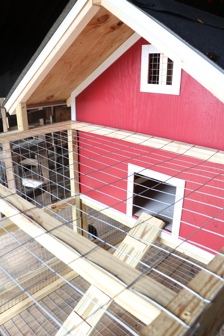 This is a picture of a red chicken coop built by Andrew Brake, owner of Nap Town Chickens.